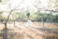 Bride Running in Apple Orchard