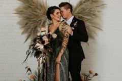Couple infront of Pampas Grass Wing Ceremony Backdrop